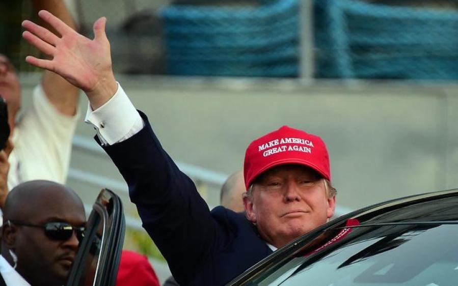 Republican Presidential candidate Donald Trump waves as leaves following a speech on board the Worl War II bettlaship USS Iowa in San Pedro, California on September 15, 2015.