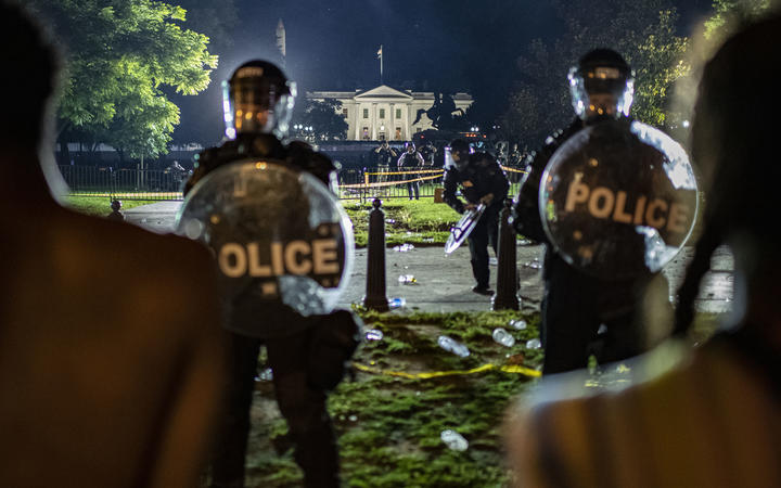 Demonstrators confront secret service police and Park police officers outside of the White House on May 30, 2020 in Washington DC.