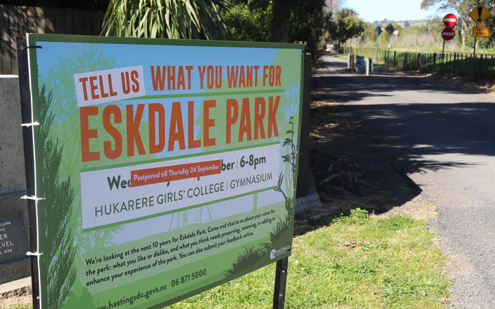 A council ad outside the park for an upcoming community meeting