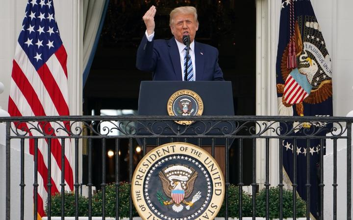 US President Donald Trump speaks about law and order from the South Portico of the White House in Washington, DC, on October 10, 2020. -