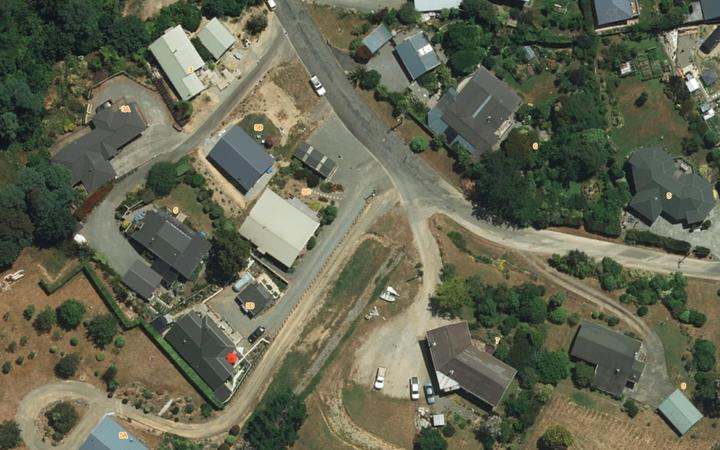 An aerial shot of properties in Havelock shows the differences in grass colours.