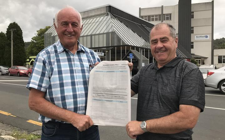 Democracy Northland campaigners John Bain (left) and Robin Grieve (right) are spearheading New Zealand's biggest Māori wards opposition polling demand campaign outside Northland Regional Council's head office in Whangārei.