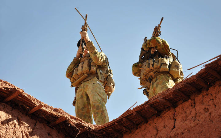 A handout photo released by Australian Department of Defence on October 21, 2009 shows Australian soldiers from the Special Operations Task Group using their rifle scopes to investigate the surrounding mountains during an operation in southern Afghanistan.
