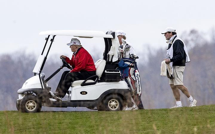 STERLING, VIRGINIA - NOVEMBER 21: US President Donald Trump golfs at Trump National Golf Club on November 21, 2020in Sterling, Virginia.