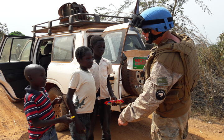 One of the New Zealanders on patrol with the UN Mission in South Sudan, talking and sharing treats with children near Juba.
