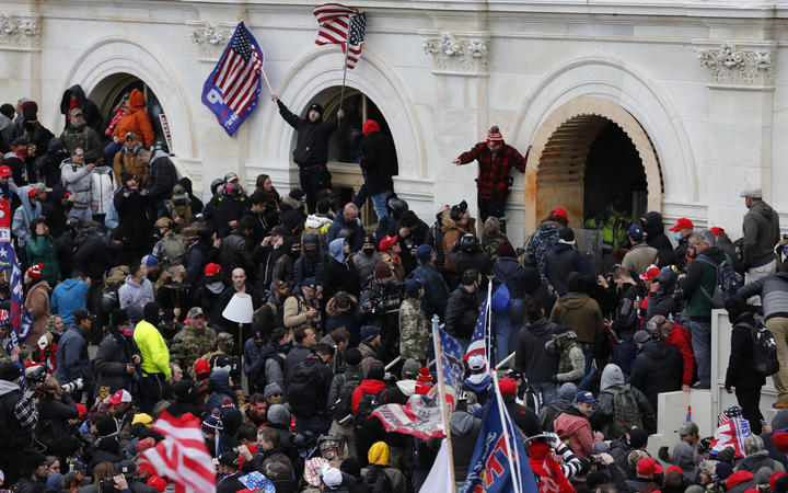 Supporters of US President Donald Trump storm the US Capitol during a rally to contest the certification of the 2020 US presidential election results.