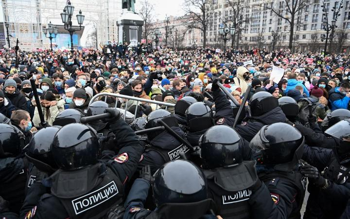 Protesters clash with riot police during a rally in support of jailed opposition leader Alexei Navalny in downtown Moscow on January 23, 2021.