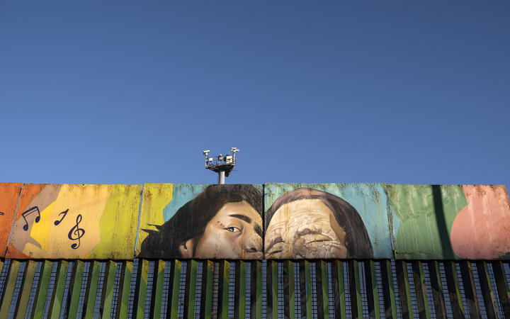 Paintings on the US-Mexico border at the Friendship Park seen from Baja California state in Mexico on January 16, 2021.