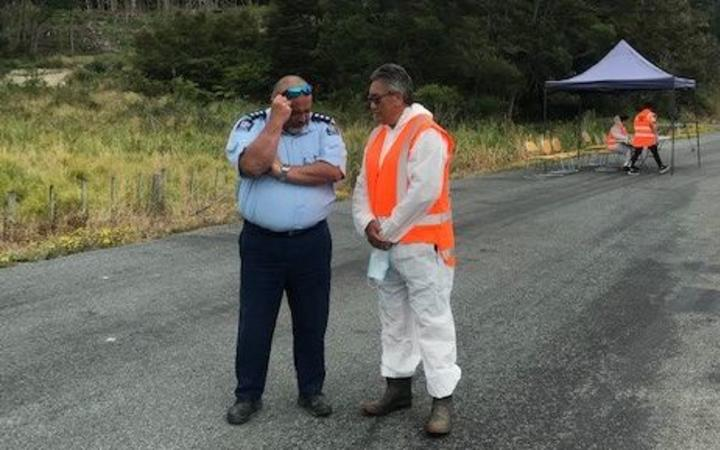 Hone Harawira talks to Inspector Riki Whiu at Waiomio checkpoint in Northland