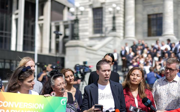 Green Party members and supports rally in support of a ban on gay conversion therapy.