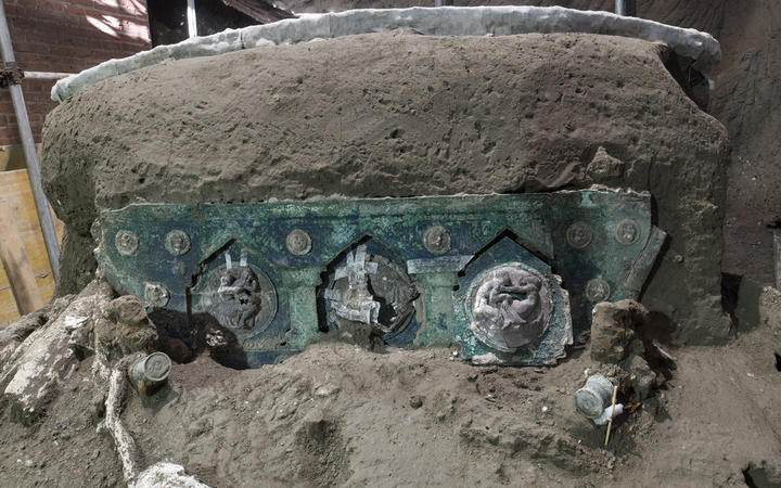 A large Roman four-wheeled ceremonial chariot after it was discovered near the The archaeological park of Pompeii.