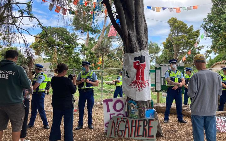Police at Canal Rd in Avondale where protesters are trying to prevent 23 native trees being removed.