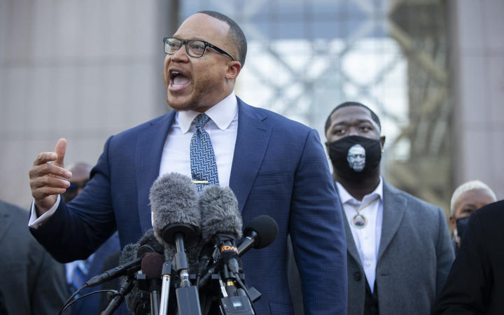 Justin Miller (left), attorney representing George Floyd's daughter, speaks during a conference in front of the Hennepin County Government Center at the start of the trial of former officer Derek Chauvin over the death of George Floyd in Minneapolis, United States on March 29, 2021.