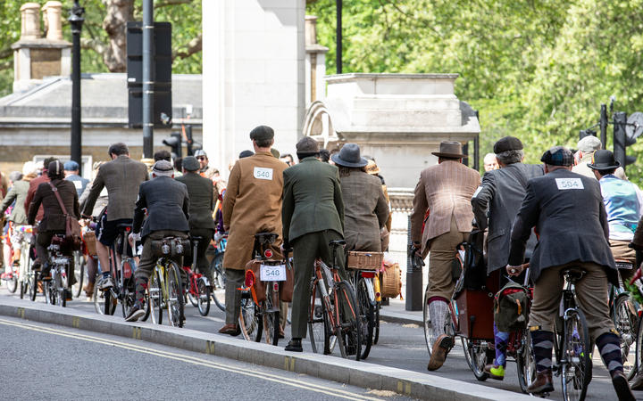 LONDON, UK - May 4, 2019. London Tweed Run. People with old bicycles and clothes
