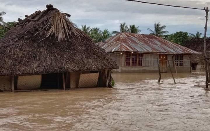 This general view shows homes surrounded by floodwaters in the village of Haitimuk in East Flores on April 4, 2021, after flash floods and landslides swept eastern Indonesia and neighbouring East Timor.