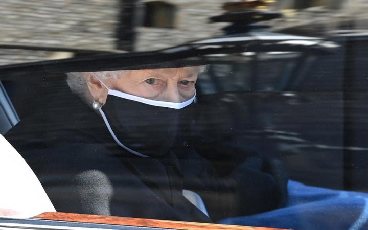 Britain's Queen Elizabeth II arrives in the Royal Bentley at the funeral for her husband, Britain's Prince Philip, Duke of Edinburgh to St George's Chapel in Windsor Castle in Windsor, west of London, on April 17, 2021.