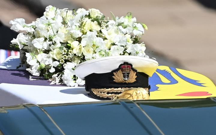 A wreath of flowers lies on the coffin during the ceremonial funeral procession of Britain's Prince Philip, Duke of Edinburgh to St George's Chapel in Windsor Castle in Windsor, west of London, on April 17, 2021.