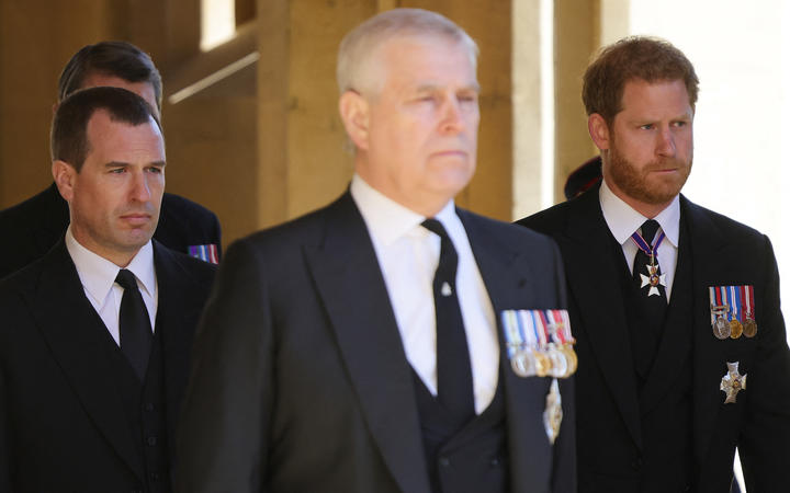 Prince Andrew and Prince Harry leave the chapel after the service
