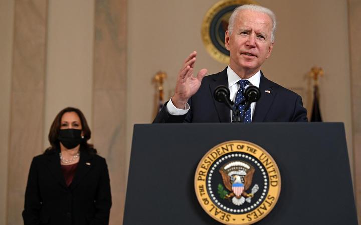 Vice President Kamala Harris listens as US President Joe Biden delivers remarks on the guilty verdict against former policeman Derek Chauvin at the White House in Washington, DC, 20 April 2021.
