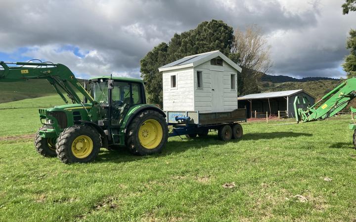 Paeroa farmer Bart Van de Ven moving has also had to move his daughters' playhouse.