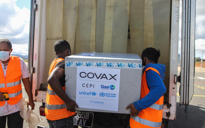 Workers load boxes of Oxford/AstraZeneca Covid-19 vaccines, part of the the Covax programme, into a truck after they arrived by plane at the Ivato International Airport in Antananarivo, Madagascar, on May 8, 2021.