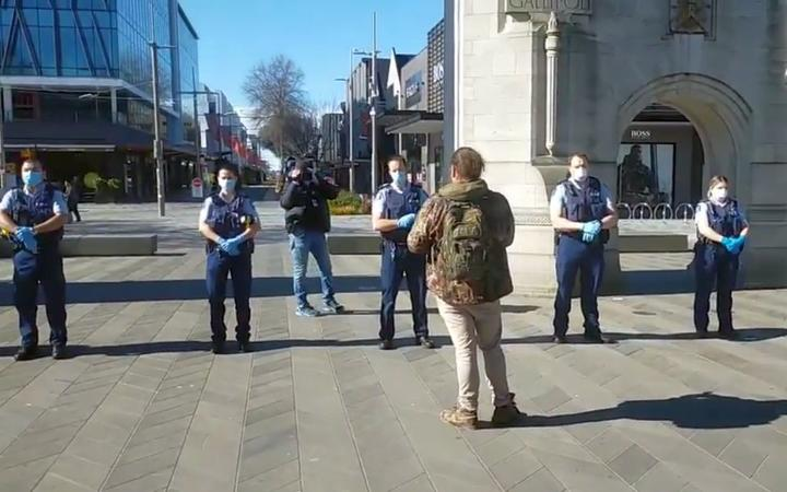 The police line up at an anti-lockdown protest in Christchurch.