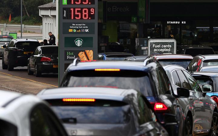 Motorists queue for petrol and diesel  at a petrol station off the M3 motorway near Fleet, west of London, on 26 September 2021.