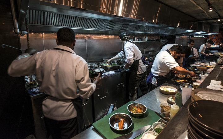 Kitchen staff in Cassia Restaurant on Fort Lane, Auckland City.