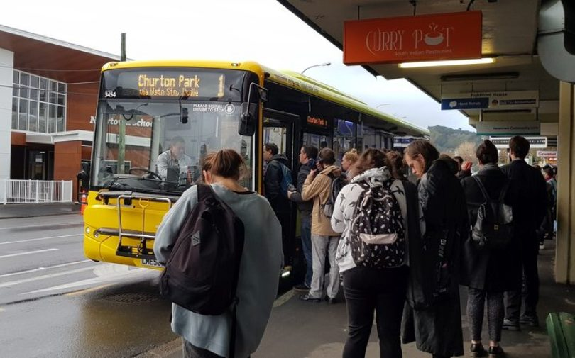 Commuters at a bus stop in Newtown
