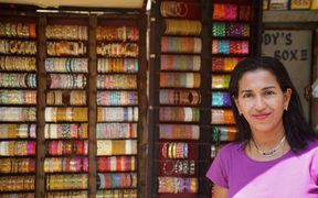 Shobha Narayan in front of a street store.