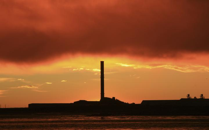 21586193 - a vibrant sunrise overlooking bluff aluminium smelter new zealand