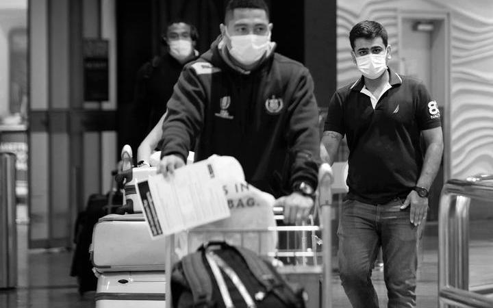 Travellers arrive at Auckland Airport amidst the Covid-19 pandemic