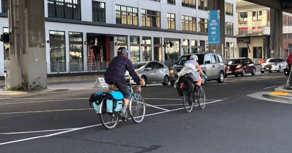 commuters riding bicycles in traffic