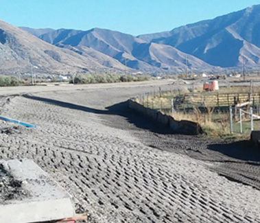 Figure 4 Soil slope --- A gentle 1:6 slope (approx.) at the edge of a new road under construction in Provo, Utah