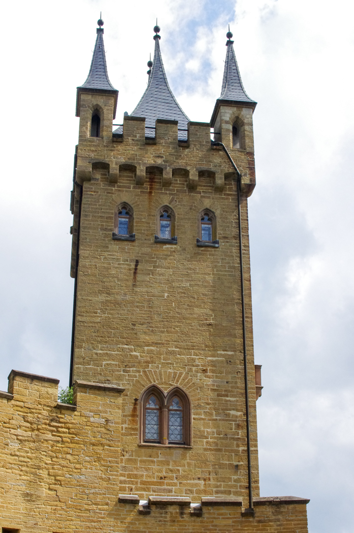 The entrance tower of the Hohenzollern Castle in Germany - Check out roadtripsaroundtheworld.com to find out more
