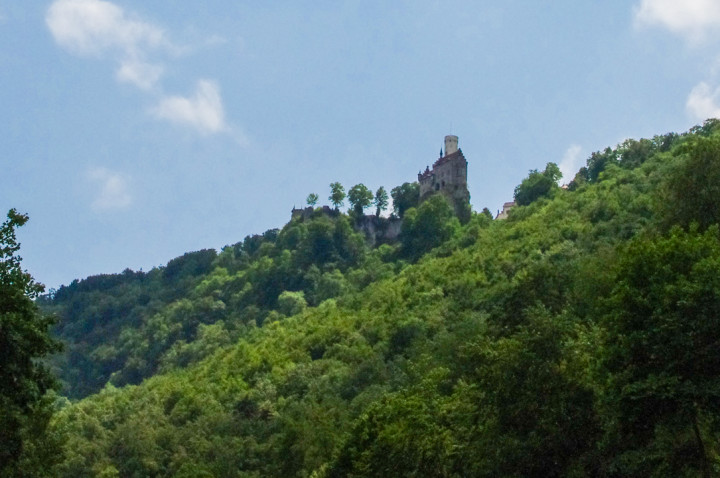 View of the Lichtenstein Castle from the road in the valley - Germany road trip on roadtripsaroundtheworld.com
