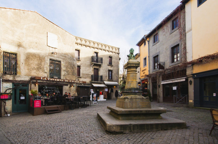 A square in Carcassonne - learn more on roadtripsaroundtheworld.com