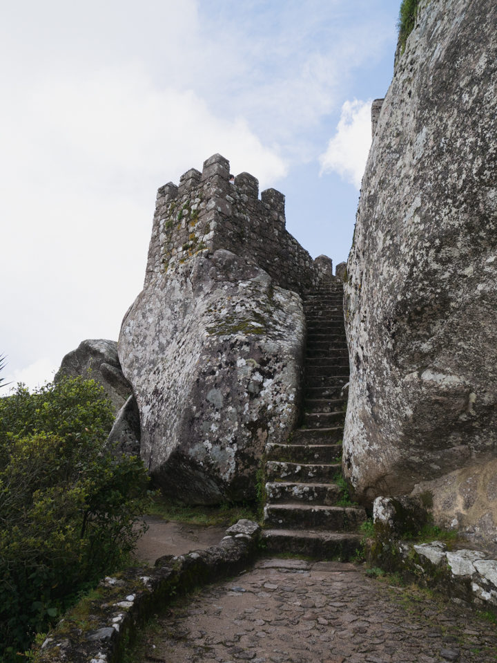 At the footstep of the Royal Tower of the Moors Castle, Sintra - Portugal - Learn more on roadtripsaroundtheworld.com