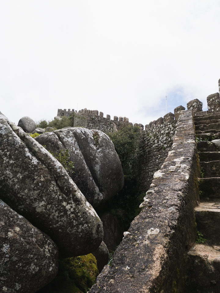 Reaching the top... at the Moors Castle, Sintra - Portugal - Learn more on roadtripsaroundtheworld.com