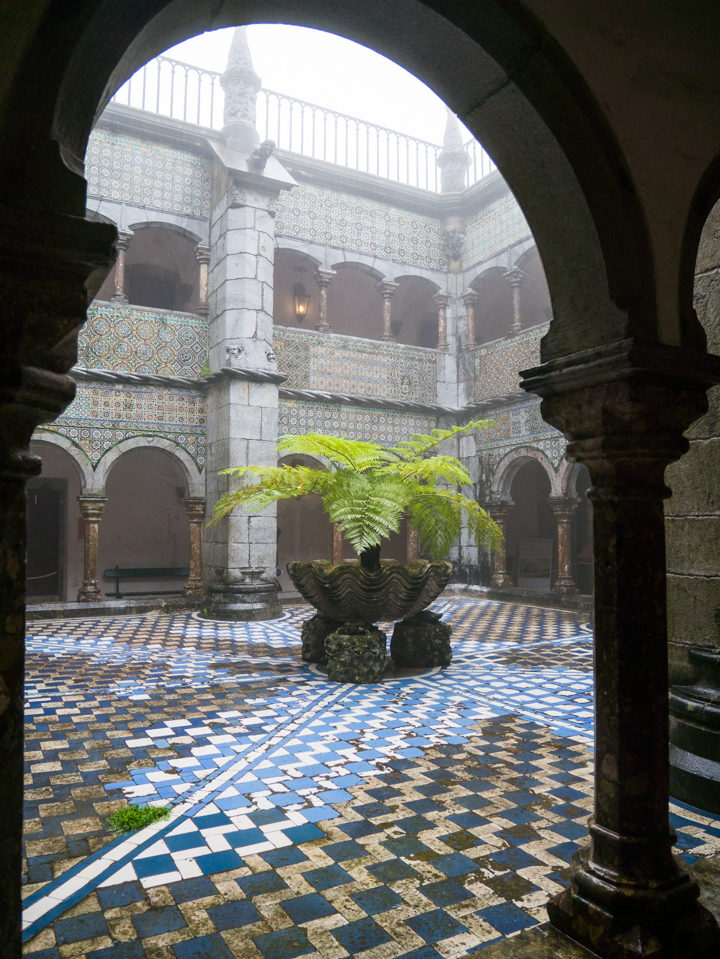 The 16th Cent. Manueline Cloister of the Pena Palace - Sintra, Portugal - Learn more on roadtripsaroundtheworld.com