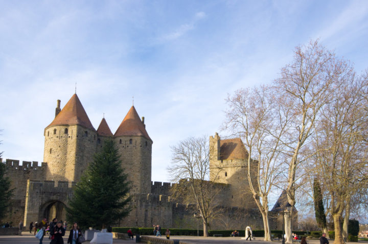 The Narbonnaise gate at Carcassonne - learn more on roadtripsaroundtheworld.com