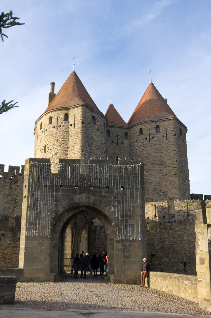 The Porte Narbonnaisse at Carcassonne - learn more on roadtripsaroundtheworld.com