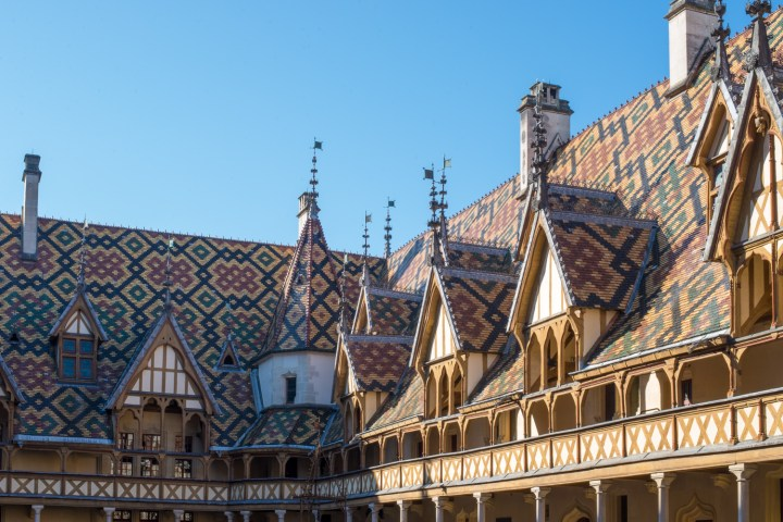 The famous roof of the Hospices of Beaune, Burgundy - France - www.RoadTripsaroundtheWorld.com