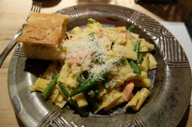 Homemade focaccia with penne, salmon, green beans and Parmesan
