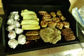 A grill full of meat (and corn and potatoes)