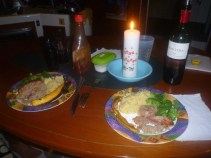 A simple Thanksgiving dinner with a candle in memory of our two dogs (gift of my cousin)