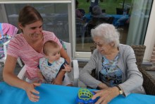 Oma playing with her youngest grandchild Lenn, my brother's son