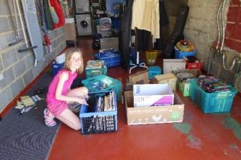 Niece Lena helps me organize a yard sale