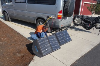 Mark installs the wiring for our new solar panels.