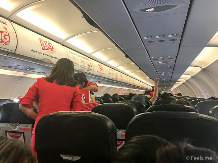 Air Asia SIN BKI Review Busy flight attendant